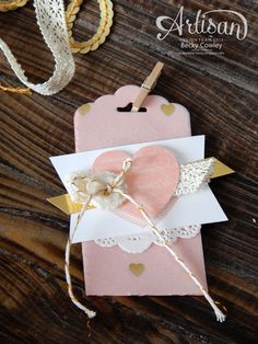 Scallop tag punch, Gold twine, doily, heart punch Gold foil sheets & vellum, mini clothes pins, crochet ribbon, embellishment