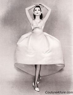 Deep yellow satin dress with a huge bell shaped skirt by Balenciaga. 1958