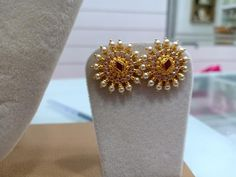 Stunning gold ear tops studded with rubies and emeralds. Ear tops in lotus flower design. Ear tops studded with pearls. Pearl Necklace Designs, Jewelry Design Earrings, Gold Earrings Designs, Designer Earrings, Gold Necklace, Gold Bangles Design, Gold Jewellery Design, Gold Jewelry Simple, Lotus Flower