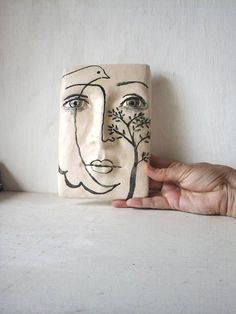 Black and white tile face sculpture ceramic wall art