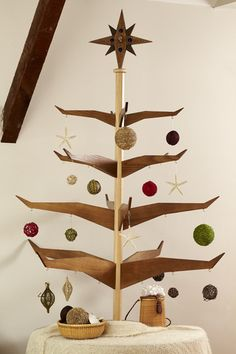 Put some festive cheer in small spaces with these space-saving tree alternatives.