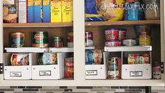 Those stylish boxes with label holders from IKEA are a favorite in offices everywhere. But when you cut a hole into one of the sides, you can stack canned foods by category (tomato sauces, vegetables) without lifting a lid to retrieve 'em.