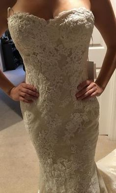Pronovias Princia/21007001.730.38: buy this dress for a fraction of the salon price on PreOwnedWeddingDresses.com