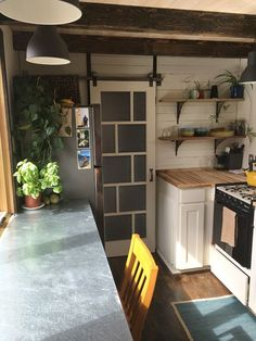 The tiny house is complete with a normal size refrigerator, oven, and a washer/dryer combo in the bathroom.