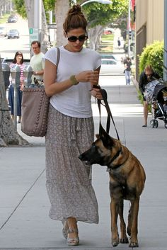 Love the maxi skirt! It's very chic how she wears it with that plain tee... oh and I love the bag as well!