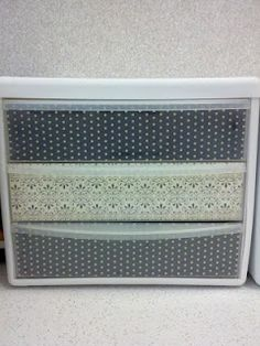 Sterilite 3 drawer makeoer: Laminate scrapbook paper and attach it with scrapbook adhesive to top and front of drawers.