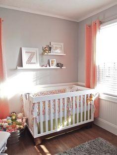 Light grey walls with orange curtains pink rug and splash of purple