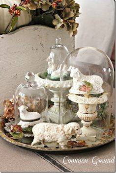 spring cloche vignette group several cloches on a plate or tray