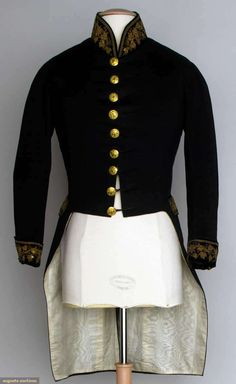 "AMERICAN COAT WORN AT FRENCH COURT, 1840 Black wool broad cloth tailcoat, velvet cuffs, pocket flaps & band collar all w/ gold embroidery, gold buttons stamped w/ eagle & surmounted by band ""E Pluribus Unum"", ivory silk moire lining, Ch 36"", CF L 19"", CB L 36.5"", (minor moth damage & light stains on back) very good. Provenance William Shimmin, Mass."