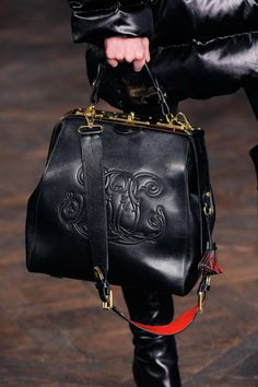 Just bought a purse with a similar vibe.  Love it! FALL 2013 RTW RALPH LAUREN COLLECTION.