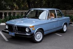 1974 BMW 2002tii. Bring-a-trailer, you find some gems...and this one is kind of in my neighborhood. Nice restoration.