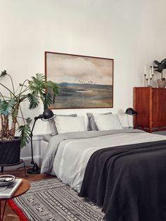 lovely grays. lovely artwork above bed. serene. also table lamp as floor lamp.- amm   dustjacket attic: