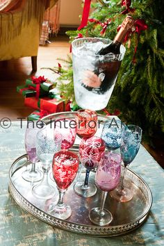 An antique silver tray with colourful wine glasses and champagne flutes for a festive glass of champagne on Christmas morning
