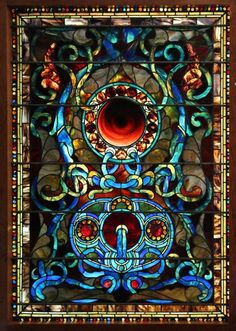 Antique stained glass window is attributed to John LaFarge - 1880