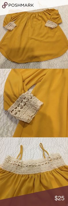 Off shoulder top Never worn. Yellow mustard color with white lace detail on sleeve and on shoulder. Also Has  spaghetti straps. Tops