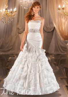 Gown features tiered skirt.