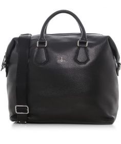 Preparing for a mini break? This Vivienne Westwood Man leather holdall is the perfect choice to carry all your essentials. With ample space and an optional shoulder strap, this weekend bag will allow you to travel with ease. Style with a pair of slim fit jeans, brown Chelsea boots and bomber jacket.