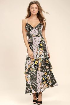 The Incense and Peppermints Black Floral Print Maxi Dress will get free love vibes flowing! Woven rayon with a swirling blend of yellow, pink, orange, and green psychedelic prints shapes a darted triangle bodice, set-in waist, and full maxi skirt with ruffled tiers along the sides. Adjustable straps. Hidden back zipper/clasp.