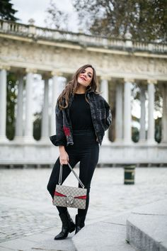 Hello Black sweater+black skinny jeans+black boots+black denim embroidered  jacket+taupe and red Gucci Dionysus chain shoulder bag. 7ddb5a5a527