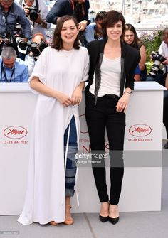 Actresses Marion Cotillard and Charlotte Gainsbourg attends the 'Ismael's Ghosts (Les Fantomes d'Ismael)' photocall during the 70th annual Cannes Film Festival at Palais des Festivals on May 17, 2017 in Cannes, France.