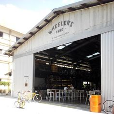 See 771 photos and 88 tips from 2871 visitors to Wheeler's Yard. Restaurant Concept, Cafe Restaurant, Warehouse Renovation, Prefab Barns, Brewery Design, Barber Shop Decor, Warehouse Design, Garage Interior, Cafe Bistro