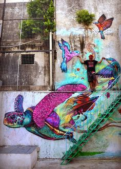 """""""BROKEN HOME"""" Street art in Cancún (Orquideas Hostel), Mexico, by artist Farid Rueda."""