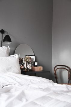 I love the way they decorated with the mirror on the bedside table!