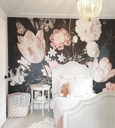Gorgeous dramatic black and pink floral wallpaper with chandelier in kids room #girlsroom #wallpaper