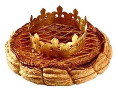 The Galette des Rois is here!!! What's a galette des rois or King's cake? It is a delicious puff pastry filled with frangipane (almond and custard cream mix) that has a charm hidden in it. The person who finds the charm becomes the king of the day and wear a crown