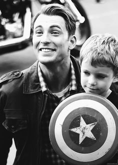 Captain America Chris Evans - So cute! It seems like captain america is even more excited than the little kid! :D