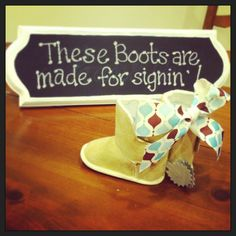 Cowboy themed baby shower. I bought little baby boots from Michaels, cut out 'spurs' from cardboard paper to glue in the back, and provided fine tip sharpe markers for guests to sign the boots :)