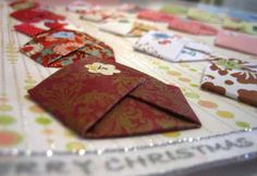 I really like this advent calendar... based on origami... this is different and really neat... I would love to make one of these for valentines day and put love notes and coupons in each day for my husband... really neat idea!
