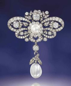 A LATE 19TH CENTURY NATURAL PEARL AND DIAMOND BROOCH -  old-cut diamond bow with similarly-set floral and foliate accents, to a central bouton shaped natural pearl and diamond cluster, suspending a further natural pearl drop, with diamond scrolling leaf surmount, mounted in silver and gold, 9.3cm long, drop detachable