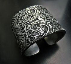 A handmade cuff bracelet created entirely from polymer clay that is unique, beautiful, and very comfortable. It can be a wonderful gift for a loved one or most probably for you as you will not want to part with it. Thr Bijouterie Fouquet cuff was stamped, formed, sanded, and painted,
