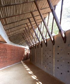 Volcanic stone dust was used to build the walls of this Buddhist education and meditation centre, designed by Sameep Padora & Associates for a woodland clearing in rural India (photos by Edmund Sumner + Tectonic Architecture, Bamboo Architecture, Tropical Architecture, Vernacular Architecture, Sustainable Architecture, Sustainable Design, Contemporary Architecture, Architecture Details, Interior Architecture
