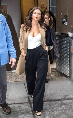 Emily Ratajkowski from The Big Picture: Today's Hot Photos  Trench coat Tuesday! The model and actress shows off her cleavage exiting The Today Show in New York.