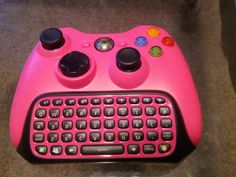 Hot pink and black xbox controller and chatpad