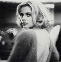 Nastassja Kinski in Paris Texas by Wim Wenders, music by Ry Cooder  the film is colour and the sweater is pink!