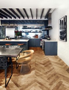 """Wolf says the floor—an often overlooked area of a kitchen—is the perfect place for a high-impact design element. """"A patterned floor will give the illusion of a greater expanse to the space."""" Wolf likes mixing it up with either chevron or herringbone wood-floor patterns or even using hand-painted cement tile for a more bohemian feel."""