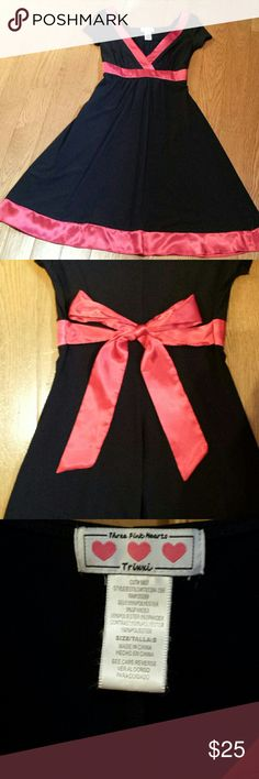 Black & Red V-Neck Dress Great condition. Size small. Trixxi black dress with red trim and back tie. Beautiful, flattering and fun dress to add to your closet. From smoke free & pet free home. Trixxi Dresses