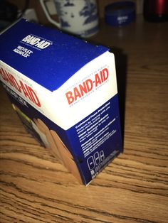 """Emphasis: this represents emphasis because of how the light hits the bandaid box and the shadow reflects on the table. When I see this the first thing I notice is the red bold color of the word """"band-aid"""" Band Aid, Bold Colors, Reflection, Words, Box, Table, Bright Colours, Boxes, Desk"""