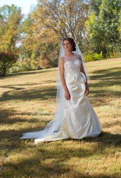 """Classic beauty in Kentucky wearing duchess silk satin and embroidered Chantilly lace. (Anne Barge """"Reece"""")"""