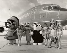 Interesting cast of characters boarding this flight.  This photo is begging for a funny caption...