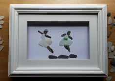 Ballerinas...or maybe they're fairies. Pebble Art, Wall art, gift ideas, sea glass Contact me for a custom made pebble artwork at: https://www.facebook.com/cornwallpebbleart