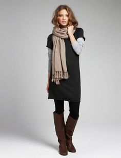 Short sleeved sweater dress over a long sleeved gray cotton tee, paired with black leggings and brown suede boots. Top it all off with an autumn scarf.