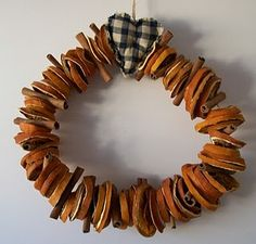 Dried orange and cinnamon wreath.