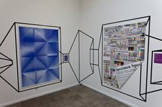 Drawing on wall with tape to create sense of 3-d spaces and spaces