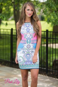This bold dress is so loud and vibrant - it's perfect for a fun night out with friends! The star is the vibrant multicolor pattern - it predominantly features lime green, pink, blue, purple, and white. There's also accents of neon yellow, sky blue, grey, teal, and orange along with black at the hemline and neckline. It also has a low cut back and a zipper.