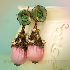 No link. Very nice fabric embellished earrings.