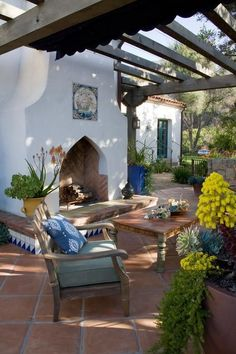 back yard = spanish tile floor with teal trim, decorative tiles, arbor love the floors
